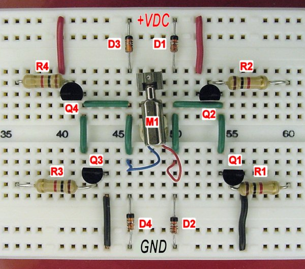 Bipolar transistor hbridge motor driver circuit on a solderless breadboard.