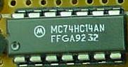 74HC14 integrated-circuit chip, plastic dual-inline package
