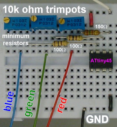 Three trimpots with resistors control the current to red, green, and blue LEDs.