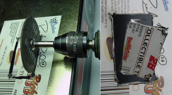 Cutting a wheel access in a metal candy container with a Dremel cut-off disc.