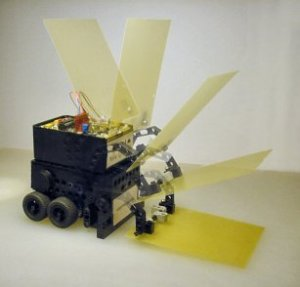 Have A Nice Day, a mini-sumo robot, lowers its scoop with a motor controlled by only a single transistor.