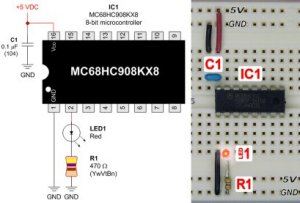 The MC68HC908KX8 8-bit microcontroller in a friendly 16-pin DIP is simple to hook up and test.