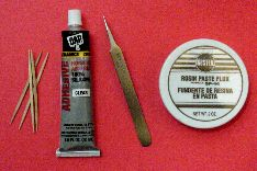 Toothpicks, silicone adhesive, tweezers, and flux paste