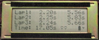 Line-following course timer LCD showing lap split, lap, and total time