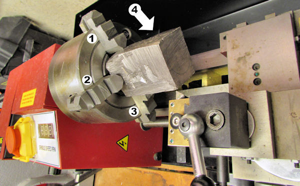 Getting ready to machine block on lathe with four jaw chuck