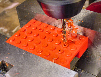 Drilling 1 8th holes in Lego plate for wires