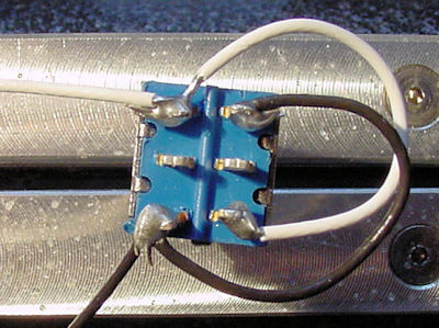 Solder the black (power negative) wires to the DPDT switch.