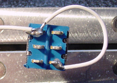 Solder the white (power positive) wires to the DPDT switch.