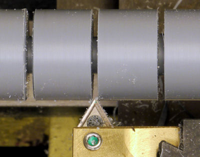Chamfering edges of cylinders on lathe