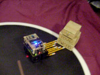 Click to see a movie of No.2 mini-sumo robot versus an inanimate block of wood.