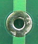 Hole with larger solder pad