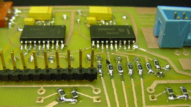 Completed double-sided PCB with surface-mounted resistors, logic chips, and capacitors