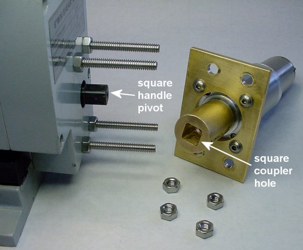 A square hole in a motor coupler mates with a square-shaped handle pivot on the shear.