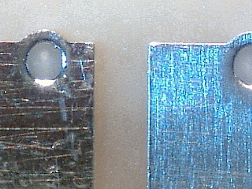 On the left, a tarnished PCB pad and hole magnified 60 times. On the right, a bright pad has been cleaned with an eraser.