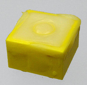 ShapeLock bonds to ABS plastic, filling in this Lego block.