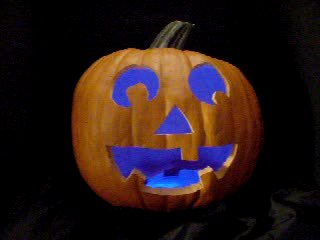 Click to see a movie of a pumpkin with a blue pulsing LED.