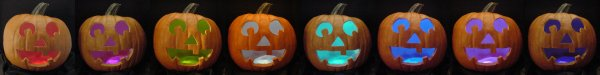 LEDs (light emitting diodes) light up a series of Halloween pumpkins in a rainbow of colors.