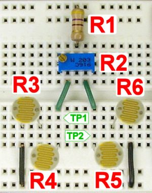 Solderless breadboard with line-following photoresistor sensors