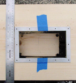 Drilling frame holes while taped in place