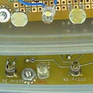 The standard Sandwich robot uses cadmium-sulfide (CdS) photoresistors (top). The Red Sandwich variation uses phototransistors (bottom).