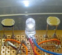 White LED as a headlight between photoresistors