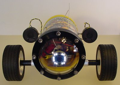 Robot with a pair of rear-mounted speakers.