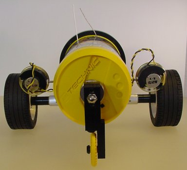 This is a three-wheel robot with an unpowered third-wheel on the rear for balance.