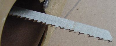 Smooth cut scroll blade