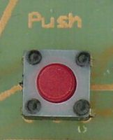 Temporary-selection pushbutton