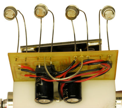 Photosensors front wire slide 1 farad capacitors and light dark line switch