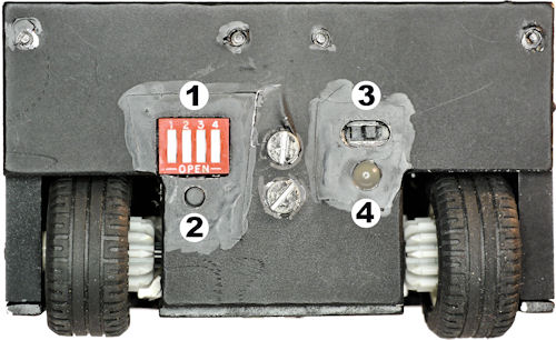 Rear panel showing DIP switch mode, power switch, start button, and bicolor LED