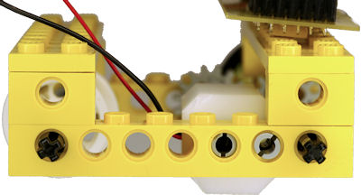 Two LEGO pegs prevent mount from pivoting in place