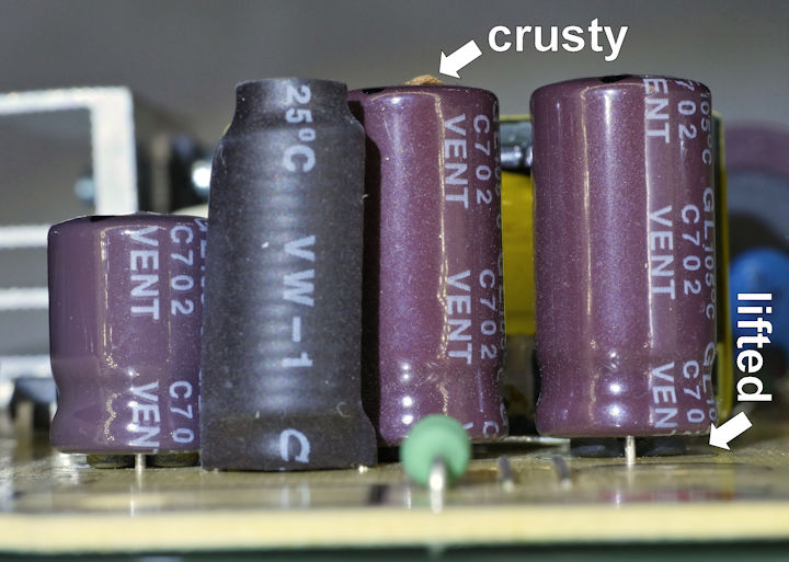Faulty capacitors that are crusty and lifted