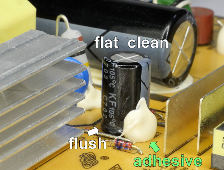 Healthy capacitor with flat clean top and flush to board